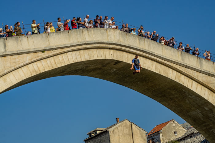 Diver jumping off Stari Most in Mostar, Bosnia - taken with the 55-210mm telephoto lens